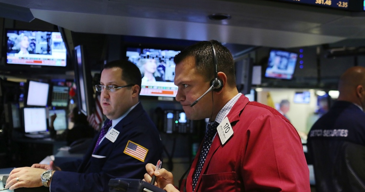 Traders work on the floor of the New York Stock Exchange on August 2, 2012 in New York City. Stocks fell sharply today after European Central Bank President Mario Draghi failed to announce plans to help resolve Europe's debt crisis.</p>