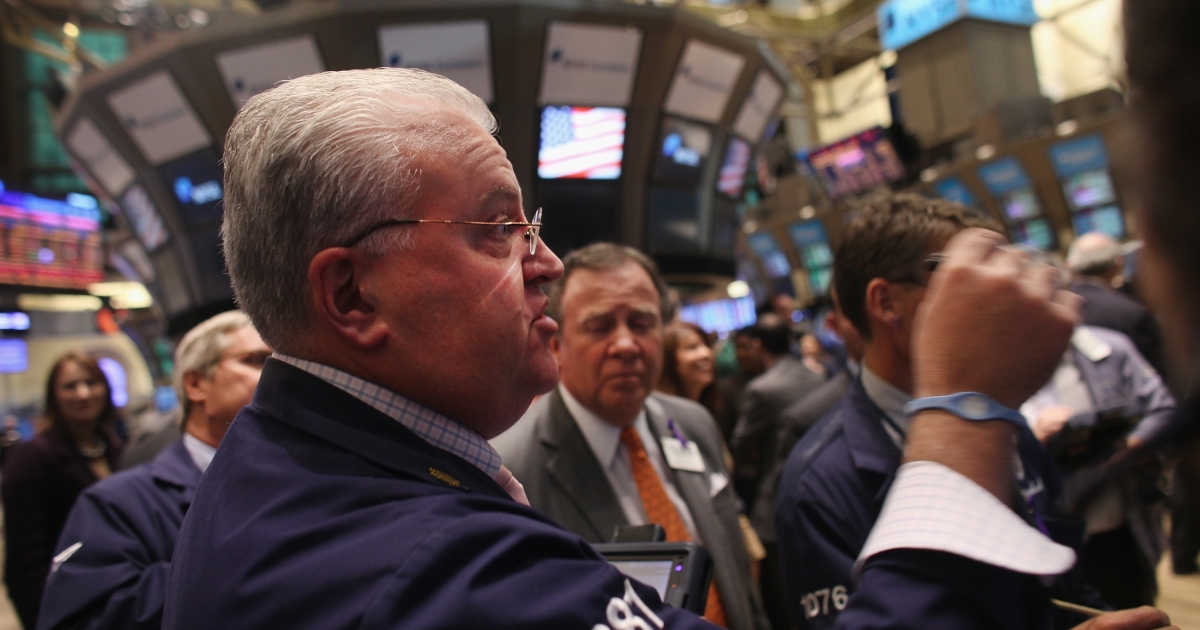 Traders work on the floor of the New York Stock Exchange in New York City on Nov. 1, 2011.</p>