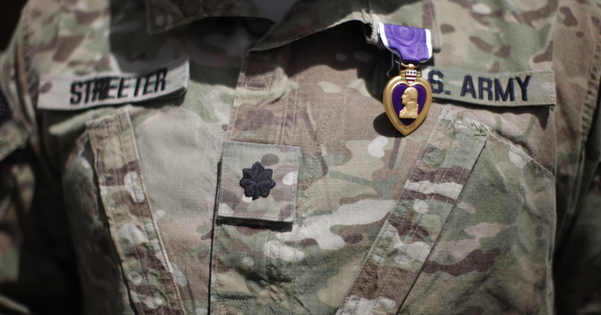 A Purple Heart medal is shown on the uniform of U.S Army Lt. Colonel Alan Streeter after U.S. Secretary of Defense Robert Gates presented the award for wounds he received in combat on May 30, 2011, during a ceremony on June 6, 2011, at Combat Outpost Andar in Ghazni Province, Afghanistan. The Stolen Valor Act aims to stop people lying about having received military medals like the Purple Heart.</p>