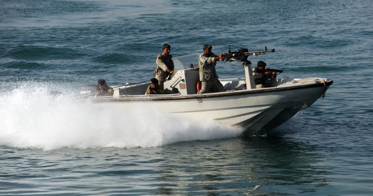 Iranian Army soldiers stand guard on a military speed boat during the 'Velayat-90' navy exercises in the Strait of Hormuz in southern Iran on December 28, 2011.</p>