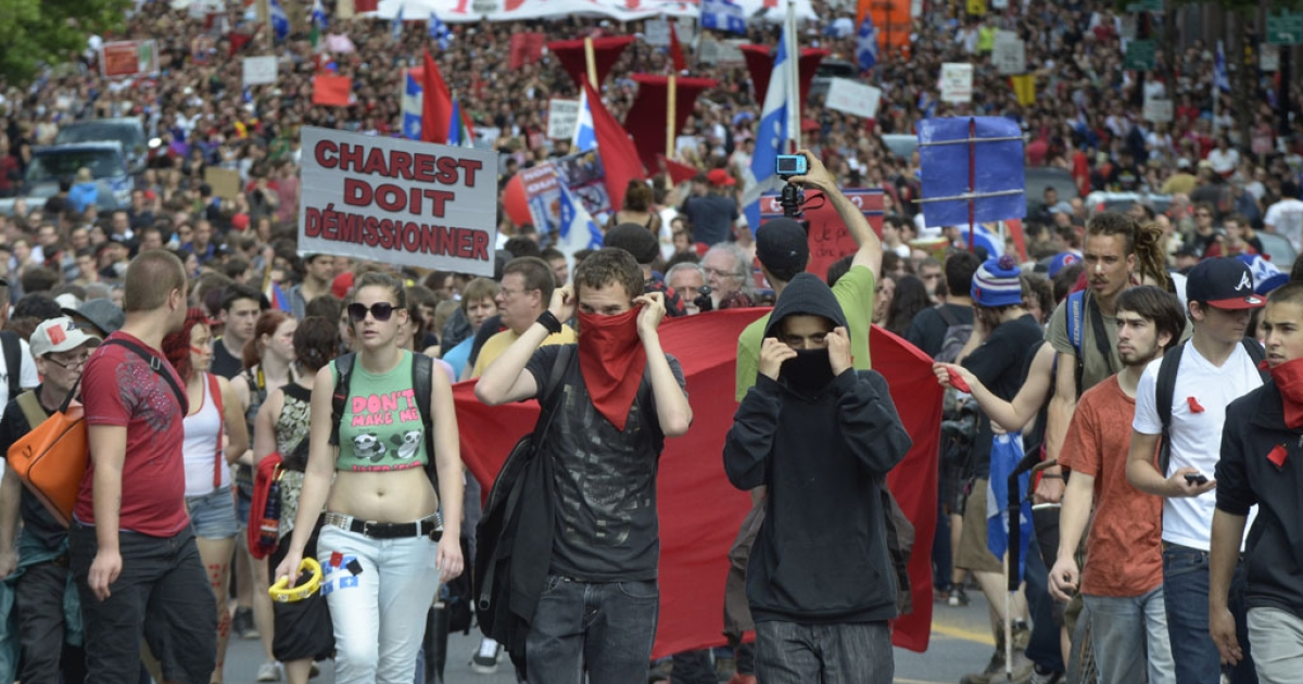 Students march in downtown Montreal on May 22, 2012, as tens of thousands defy an emergency law restricting protests to mark the 100th day of student demonstrations over plans to raise tuition.</p>