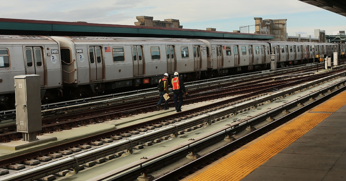 Metropolitan Transportation Authority workers walk the tracks two days after a man was pushed to his death in front of a train on Dec. 5, 2012 in New York City.</p>
