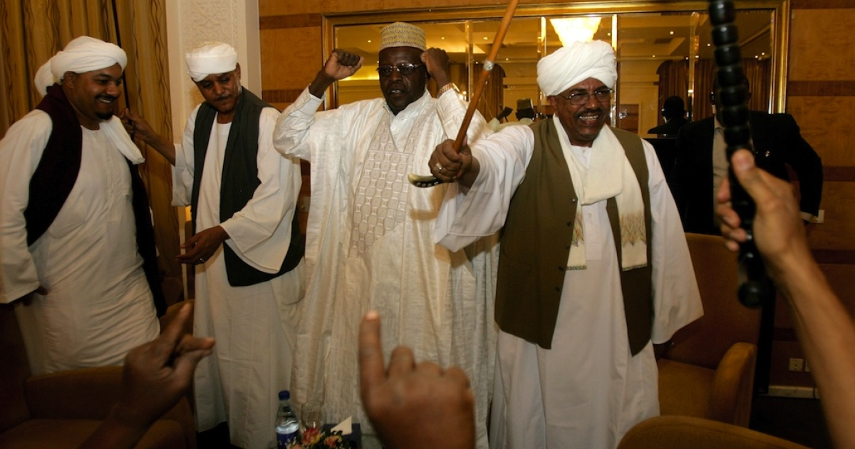 Sudan's President Omar al-Bashir (R), Sudan's Janjaweed militia leader Mussa Hilal (2nd-L) and Abdullah Nagi (2nd-R), representative of Chadian President Idriss Deby, dance during an official ceremony celebrating the marriage of Hilal's daughter Amani to Deby in Khartoum on Jan. 20, 2012.</p>