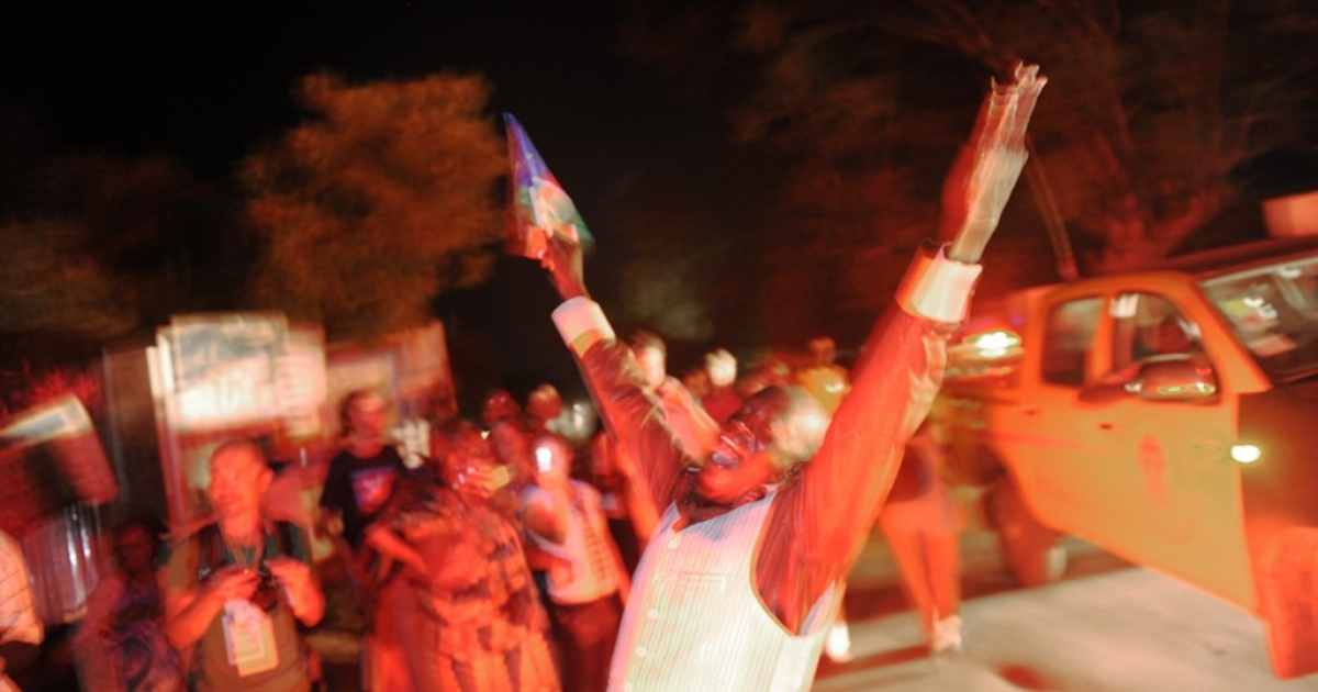 Revelers dance in the streets of Juba to celebrate the independence of South Sudan.</p>