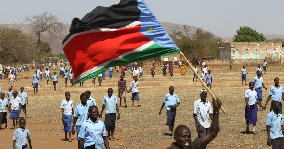 A Sudanese man waves the regional flag of southern Sudan during a protest calling for electoral reforms in the Nuba Mountains region. The Nuba people voted in favor of southern Sudan and now witnesses charge that the northern Sudan forces are killing the Nuba people in South Kordofan province.</p>