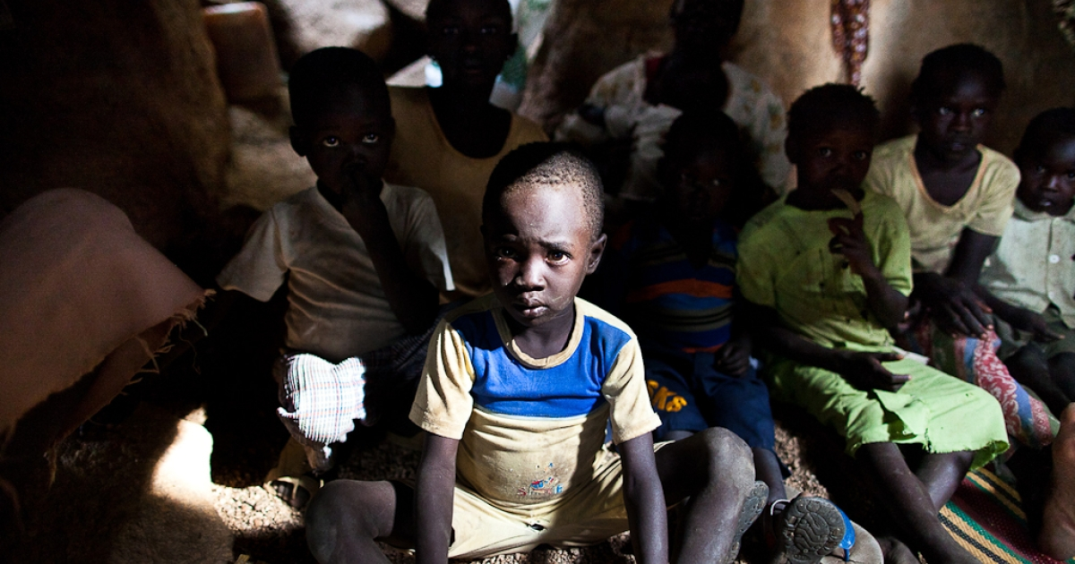 Sudanese President Omar Al-Bashir's government is resisting U.S. and UN aid.<br />Sudanese children take shelter in caves in the Nuba Mountains of South Kordofan province as government bombers pass overhead on July 13, 2011. Thousands of people from the Nuba region have fled to caves after repeated attacks by Sudan government forces on civilian areas.</p>