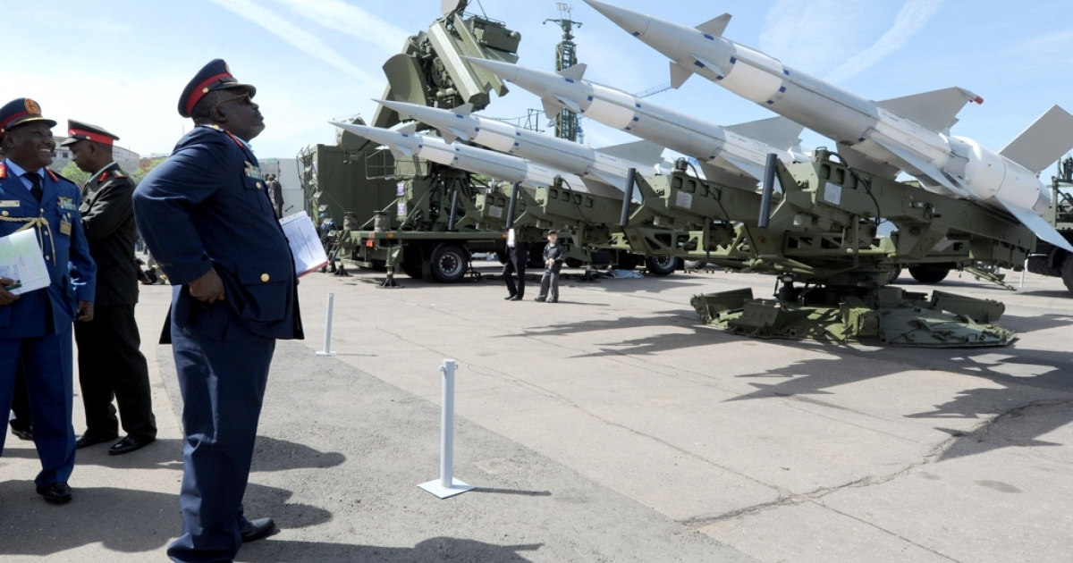 South Sudanese officers look at an air defense rocket system displayed at the MILEX-2011 arms and military equipment exhibition in Minsk on May 24, 2011.</p>