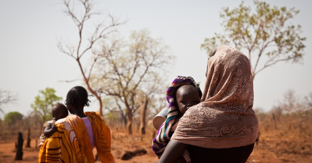In Sudan a teenaged mother has been sentenced to death by stoning for alleged adultery. Here, a different Sudanese woman with her young baby.</p>