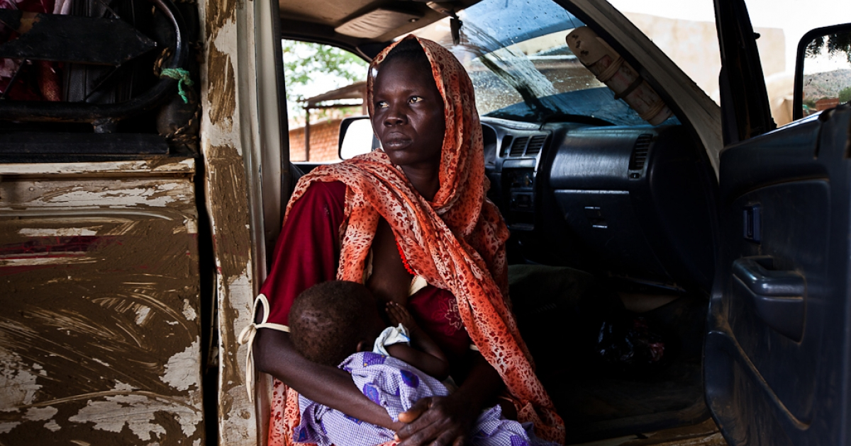 Sudan civilians injured in bombing attacks travel home on July 7, 2011. Sudan's Nuba people are afraid to return home, but say they have no choice.</p>