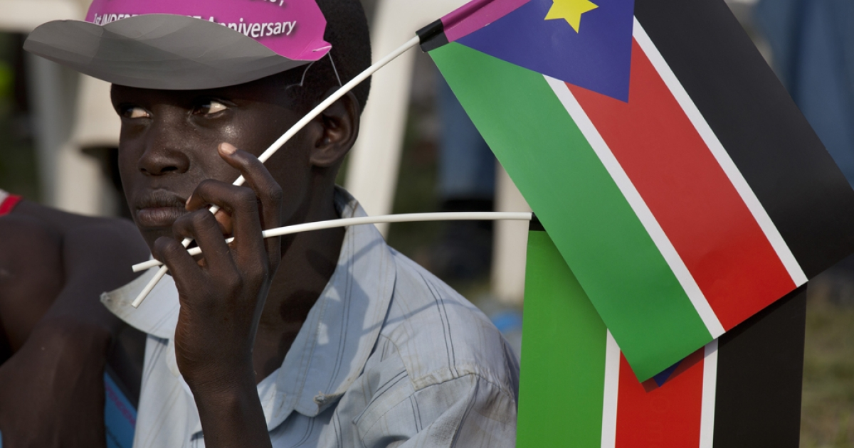 A man holds the South Sudan flag at a festival to celebrate one year of independence on July 7, 2012, in Juba, South Sudan. After breaking away from Sudan last year, South Sudan is getting ready for its first independence anniversary celebrations.</p>