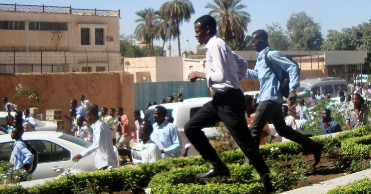 Sudanese students run during a demonstration in the capital Khartoum on December 9, 2012, as they rallied in support of four dead students originally from the conflict-plagued Darfur region, witnesses said. The death of the four has prompted a re-emergence of Arab Spring-inspired calls for the downfall of the government.</p>