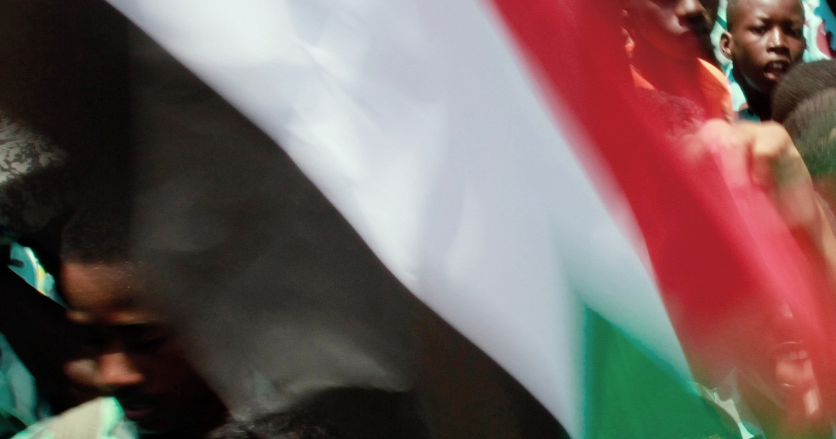 Hundreds of members of Khartoum's student union wave national flags as they protest against the Sudan People's Liberation Movement (SPLM) outside the Republican Palace in the Sudanese capital on September 5, 2011.</p>
