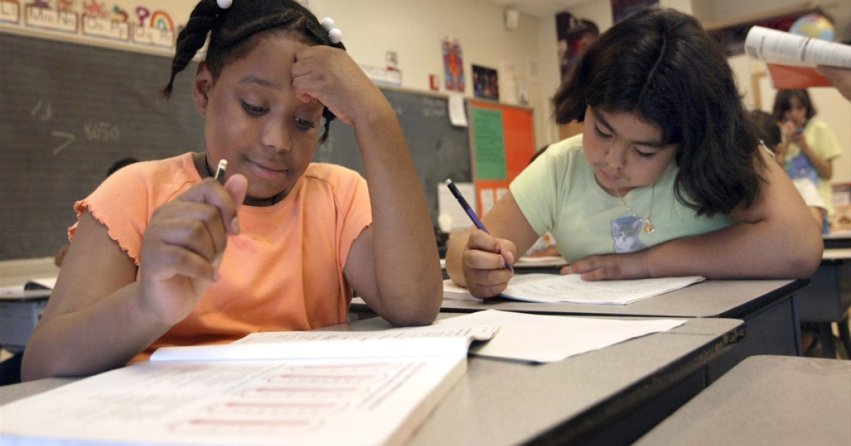 Third grade students in summer school in Chicago on July 2, 2003.</p>