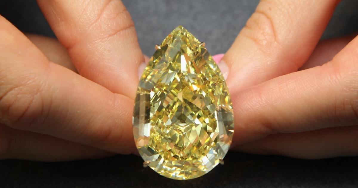 A Sotheby's employee holds a 110.3 carat sun-drop diamond on October 24, 2011 in London, England.</p>