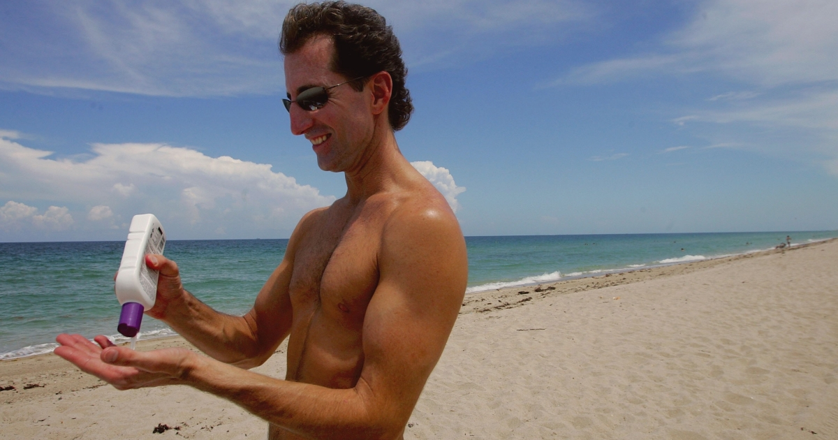 Rick Johnson applies sunscreen during a visit to the beach in Fort Lauderdale, Fla., on June 20, 2006.</p>