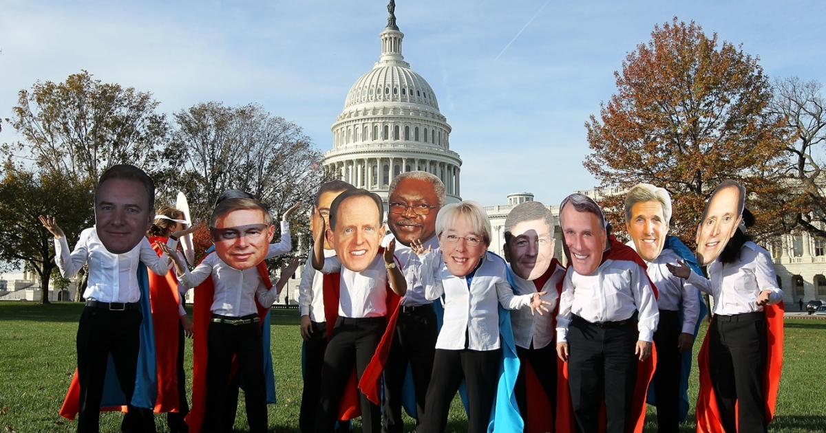 Activists of Oxfam America dress as members of the congressional Joint Select Committee on Deficit Reduction, also known as the Super Committee, as they pose for the media in front of the US Capitol October 26, 2011 in Washington, DC.</p>