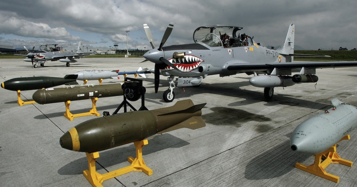 Three light attack and pilot training Super Tucano planes are shown to the Colombian press 14 December, 2006, at the military Airport in Bogota, Colombia. Colombian Airforce bougth twenty-five (25) airplanes from Brazil for surveillance mission in the forest.</p>