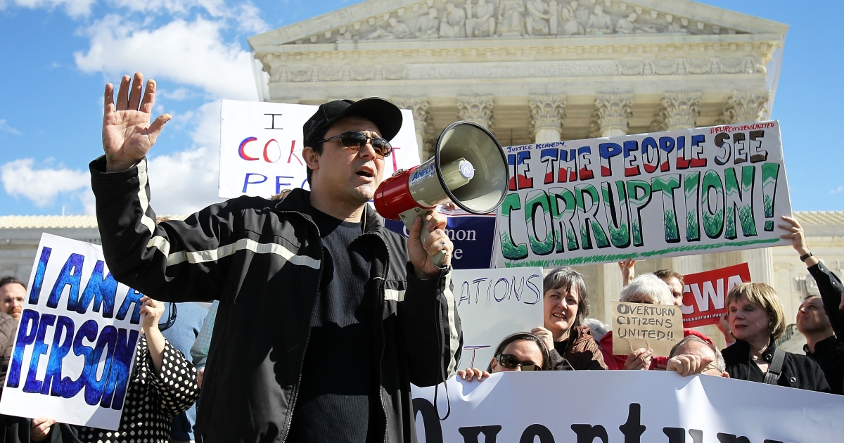 Eric Byler, head of the Coffee Party, speaks during a protest in front of the US Supreme Court in February, in Washington, DC. His group and others rallied to urge court justices to overturn Citizens United v. Federal Election Commission, a decision that prohibits the government from putting limits on political spending by corporations and unions.</p>