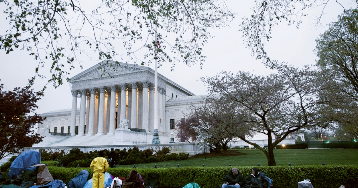 People wait in line for the second day outside the US Supreme Court March 25, 2012 in Washington, DC. The Supreme Court will hear arguments on Monday challenging the constitutionality of the Obama Administration's health care reforms.</p>