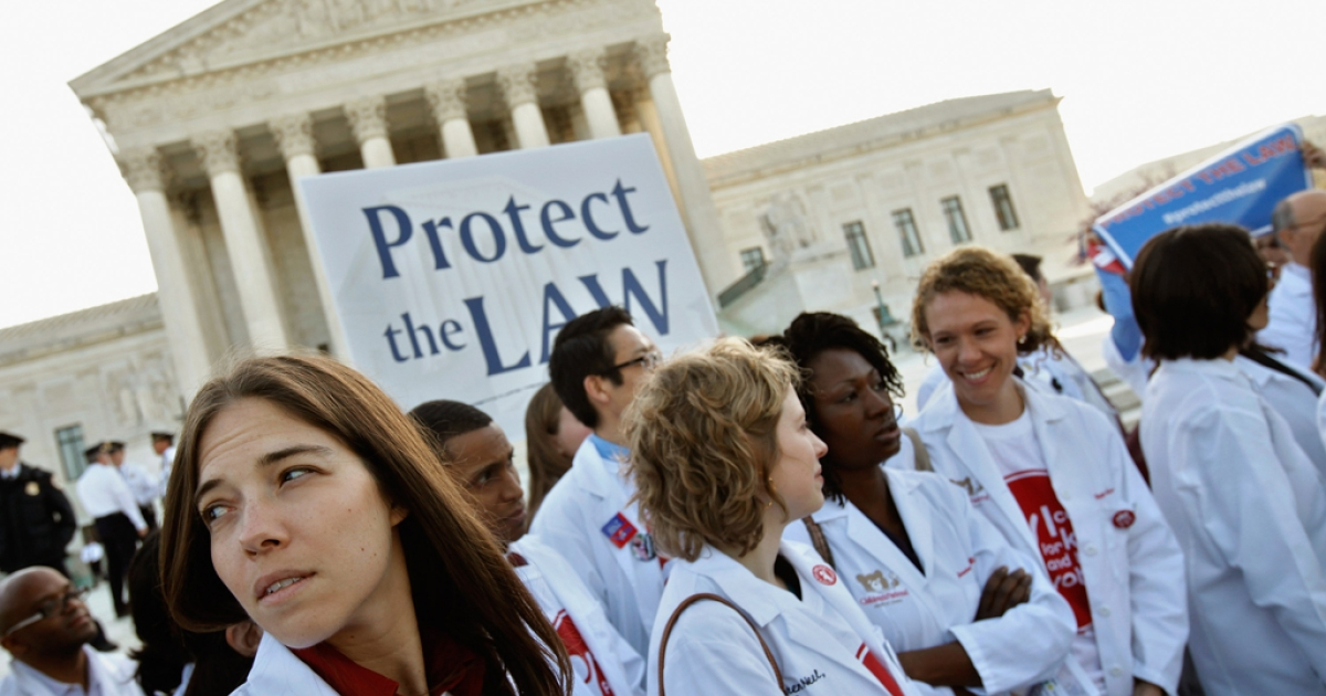 Medical students and professionals participate in a news conference in support of the Patient Protection and Affordable Care Act outside the U.S. Supreme Court Building on March 26, 2012 in Washington, DC. Today the high court, which has set aside six hours over three days, will hear arguments over the constitutionality of the act.</p>