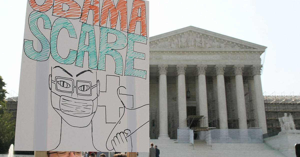 A man protests against the Obama administrations health care plan during a protest in front of the US Supreme Court, on June 28, 2012 in Washington, DC. Today the high court is expected to rule on the constitutionality of the sweeping health care law championed by President Barack Obama.</p>