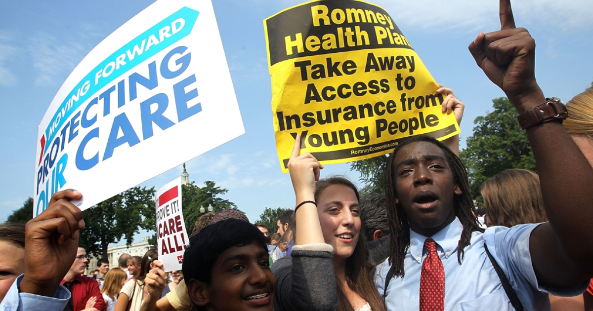Obamacare supporters, (L-R) Kailash Sundaran of Cupertino, California, Devyn Greenberg of New York City, and Devontae Freeland of Metuchen, New Jersey celebrate as they respond to the Supreme Court ruling on the Affordable Health Act June 28, 2012 in front of the U.S. Supreme Court in Washington, DC.</p>