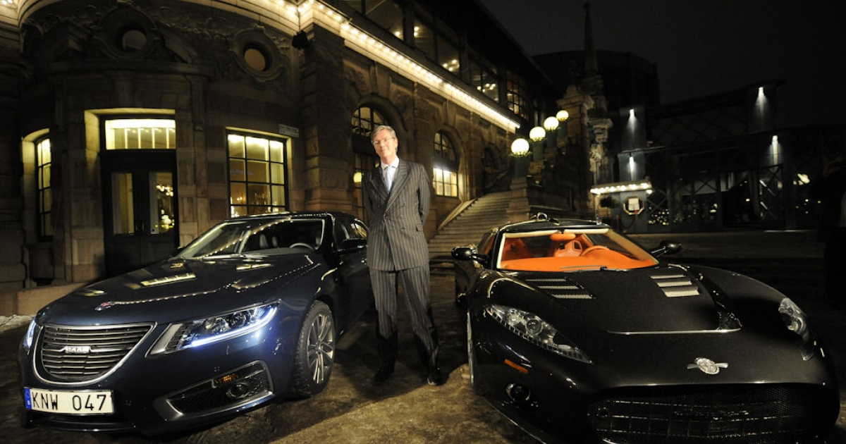 Victor Muller, CEO of Spyker Cars, poses between a Saab car (left) and a Spyker (right) in Stockholm on Jan. 26 , 2010. The failed Swedish automaker filed for bankruptcy Dec. 18, 2011 after two years of attempts to save the struggling company.</p>