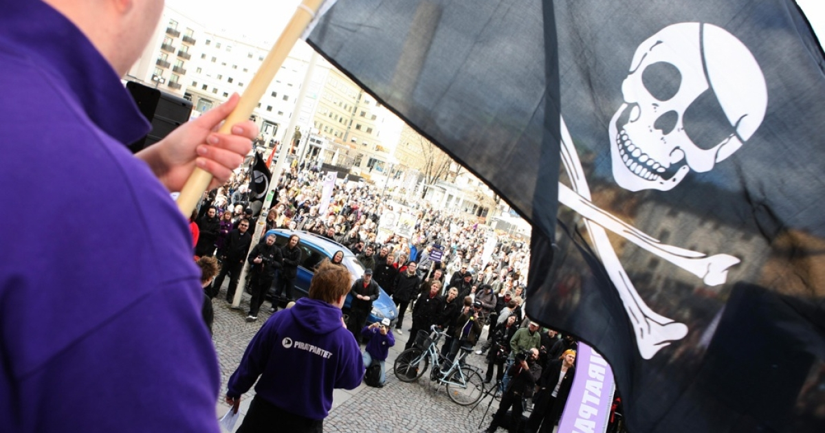 Supporters of the web site 'The Pirate Bay', one of the world's top illegal filesharing websites, demonstrate in Stockholm, on April 18, 2009, after a Swedish court sentenced four members to a year in prison for promoting copyright infringement.</p>