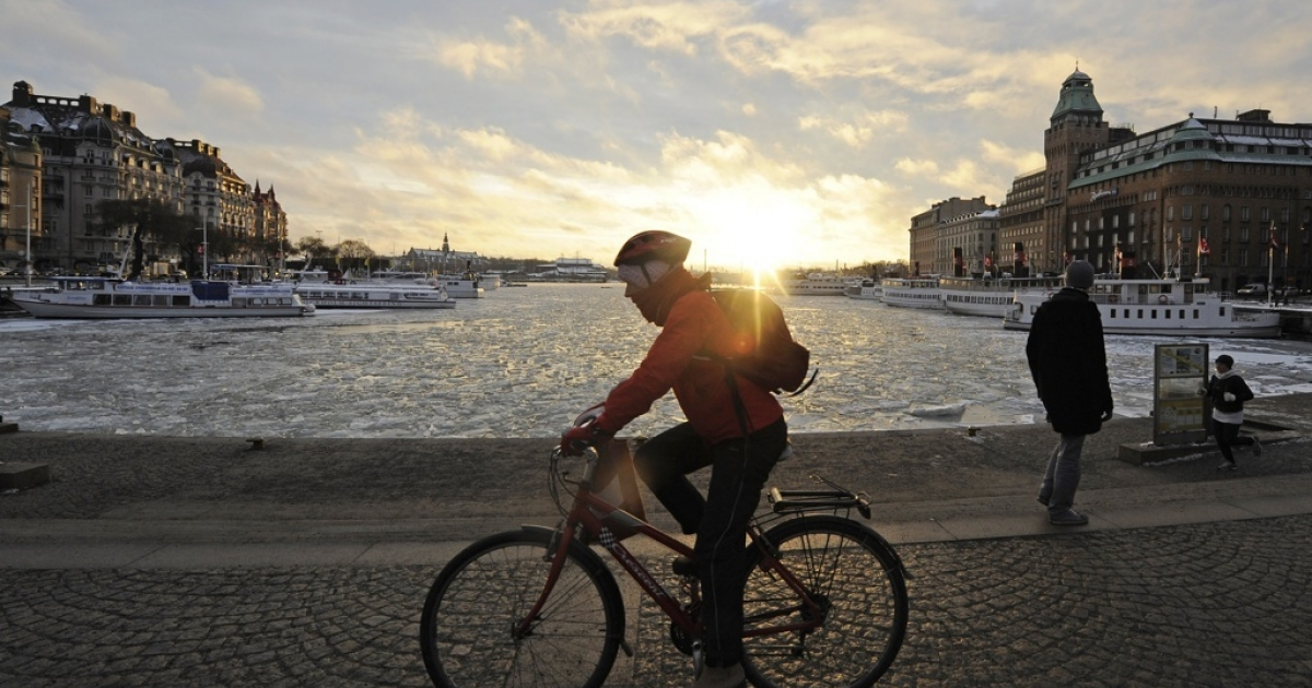A man rides to work in front of Stockholm's frozen harbor, in January 2010. Progressive policies and a tight-knit, tech culture has made Sweden a Silicon Valley rival.</p>