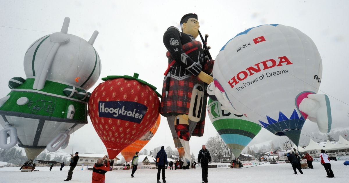 Balloonists prepare their hot air balloons for takeoff in the Swiss Alps resort of Chateau d'Oex on January 28, 2012 during the 34th International Balloon Festival. Voters in Switzerland rejected a measure to increase their minimum paid time off to six weeks in March.</p>