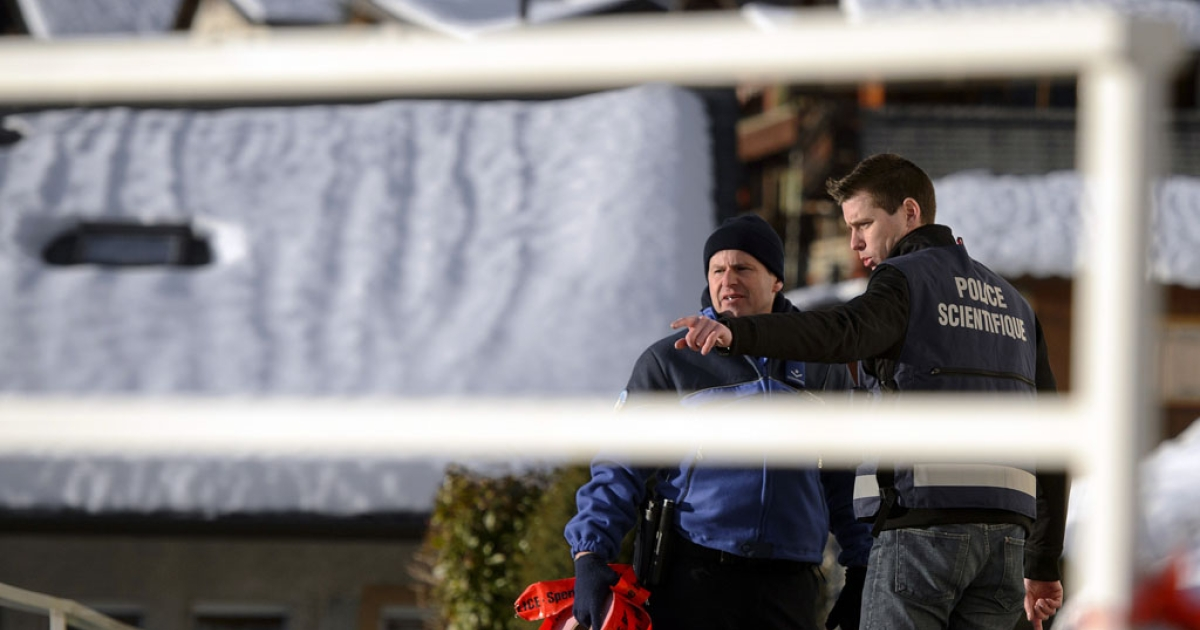 Police investigate in the Swiss village of Daillon after a gunman killed three women and wounded two men on January 2, 2013.</p>