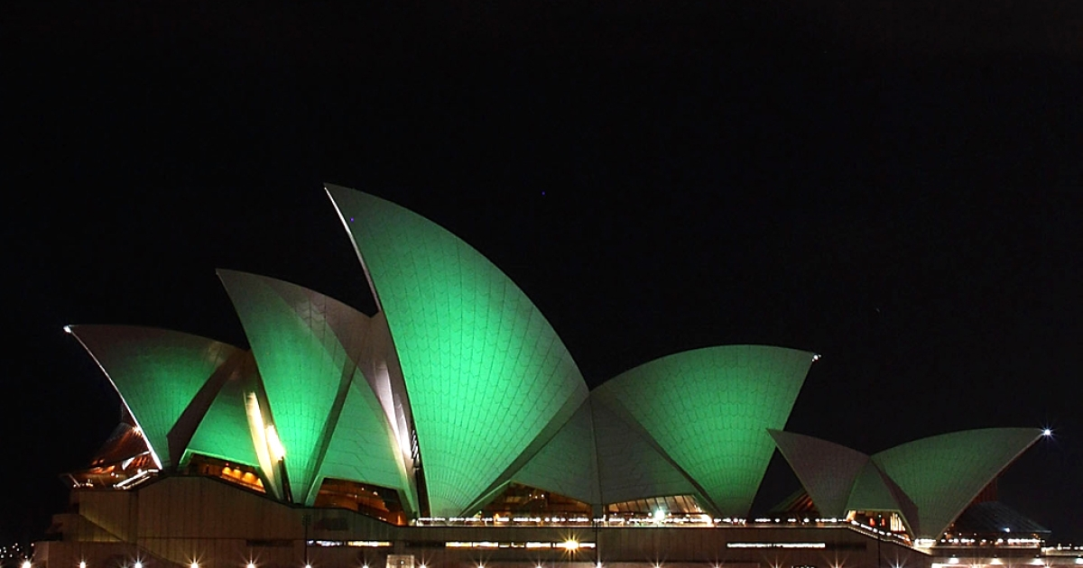 The Sydney Opera House is illuminated green on March 17, 2012 in Sydney, Australia to celebrate St. Patrick's Day.</p>