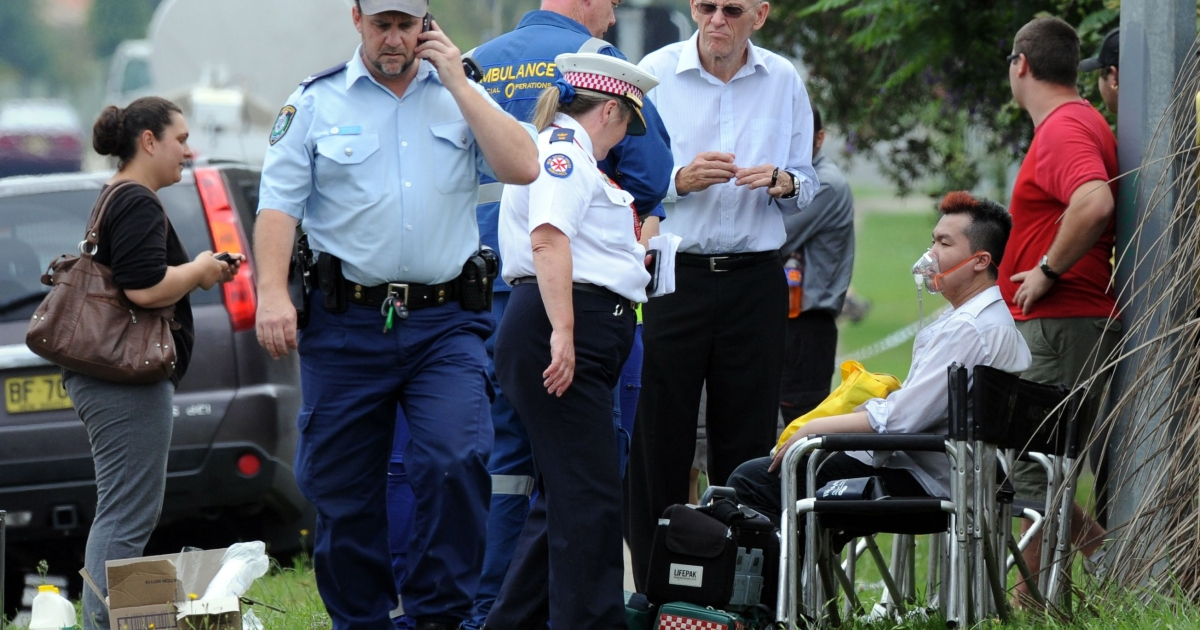 A man is given oxygen by ambulance staff after a fire engulfed a nursing home for the elderly, killing at least three and seriously injuring eight, near Sydney on November 18, 2011.</p>