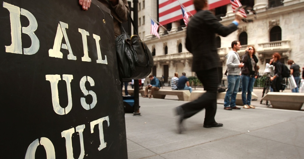 People protest outside of the New York Stock Exchange October 13, 2008 in New York City.</p>