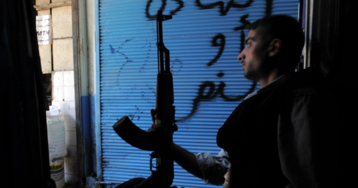 A rebel sits in a van as he checks the area in the northern Syrian city of Aleppo on Aug. 19, 2012. Syrians have reported receiving intimidating text messages telling them,