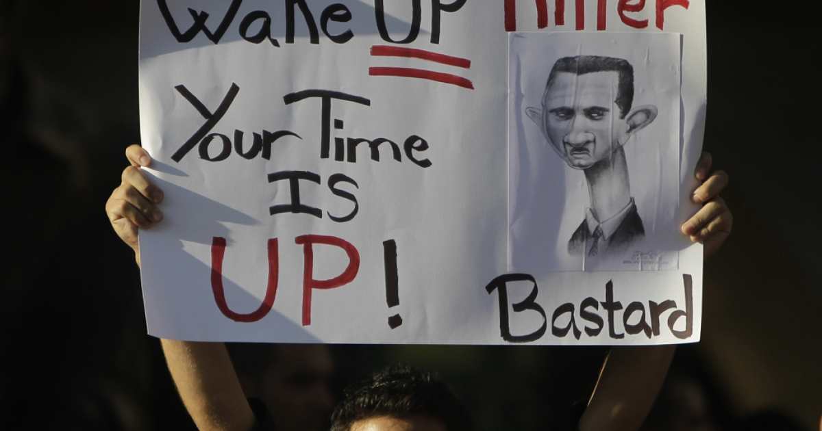 A Lebanese man carries a sign calling on Syrian President Bashar al-Assad to step down during a rally in support of Syria's ongoing anti-regime uprising in downtown Beirut on September 8, 2011. Some believe more than 3,000 have been killed in the uprising so far.</p>