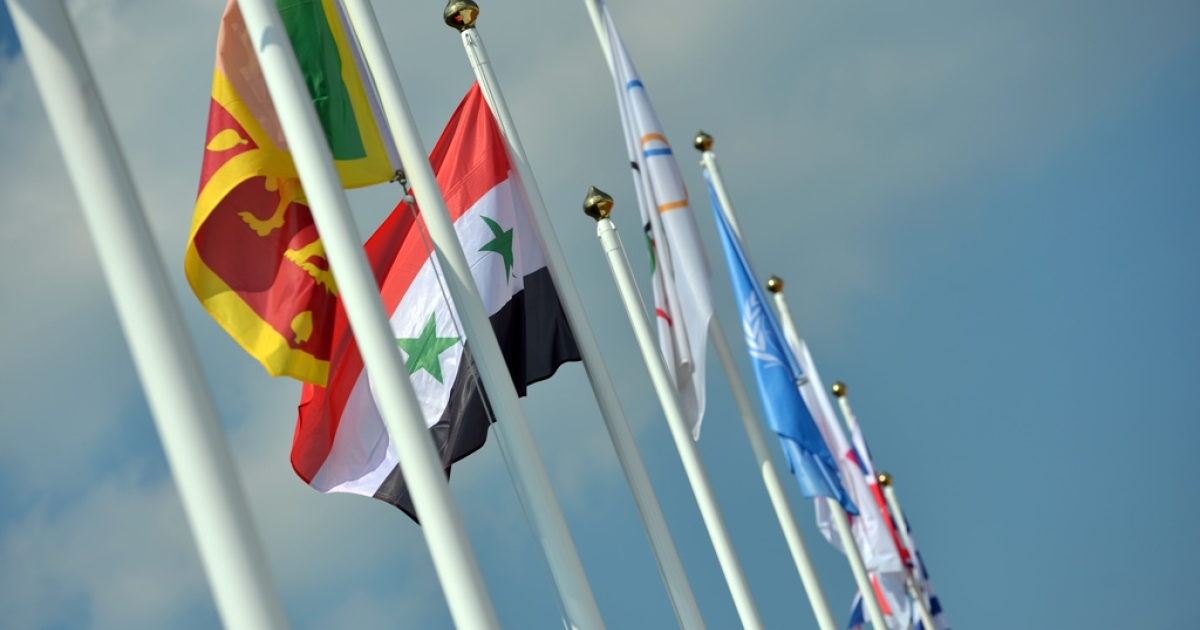 Syria's national flag flies during the flag raising ceremony at the Olympic village in London on July 25, 2012. The Syrian conflict appears to have devolved into a proxy war among world powers.</p>