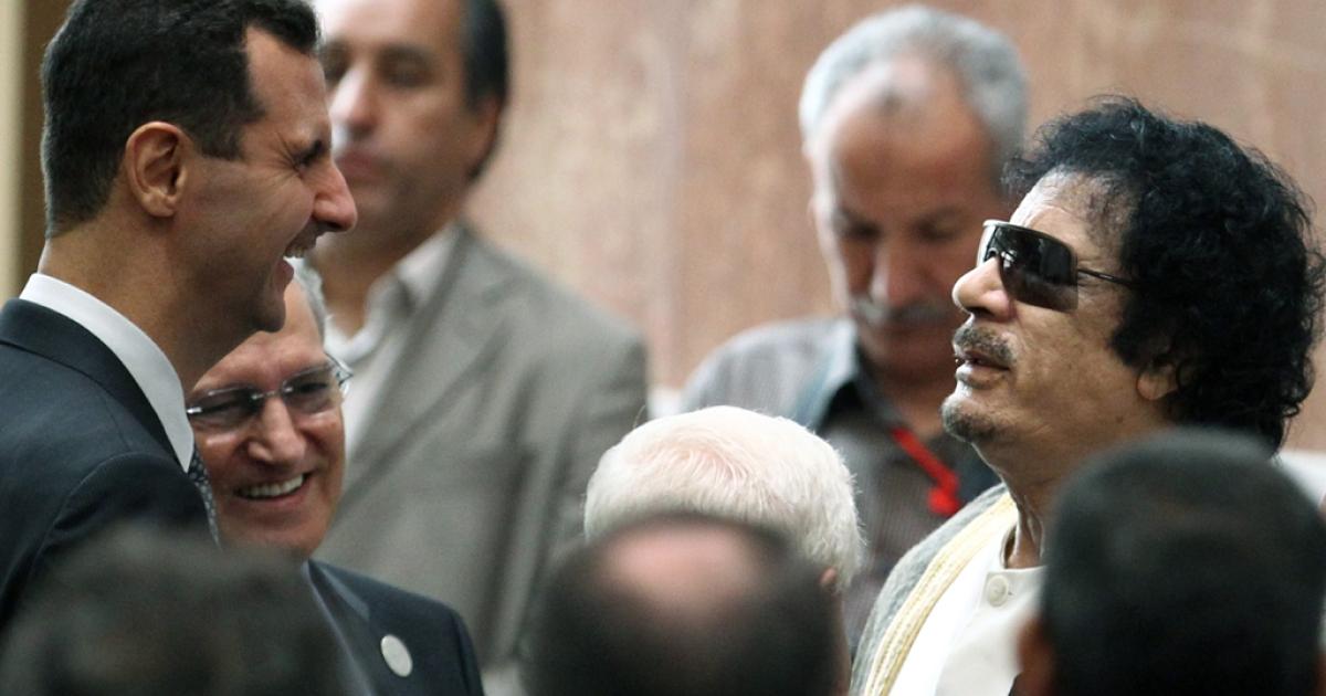 The last friend in the world still willing to listen? Syrian President Bashar al-Assad (Left) allows Libyan leader Muammar Gaddafi (Right) to rant on Syrian TV.</p>