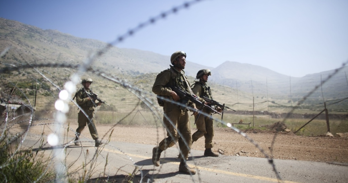 Israeli soldiers operate along Israel's border with Syria.</p>