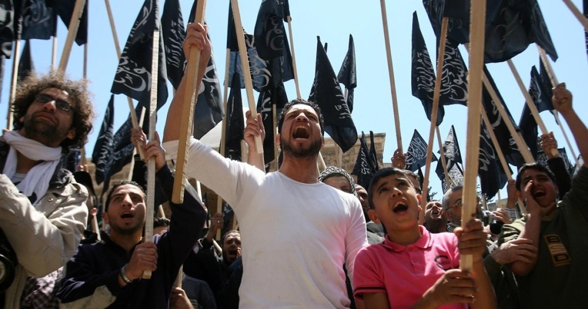 Lebanese protest Syrian President Bashar al-Assad in Tripoli, Lebanon.</p>