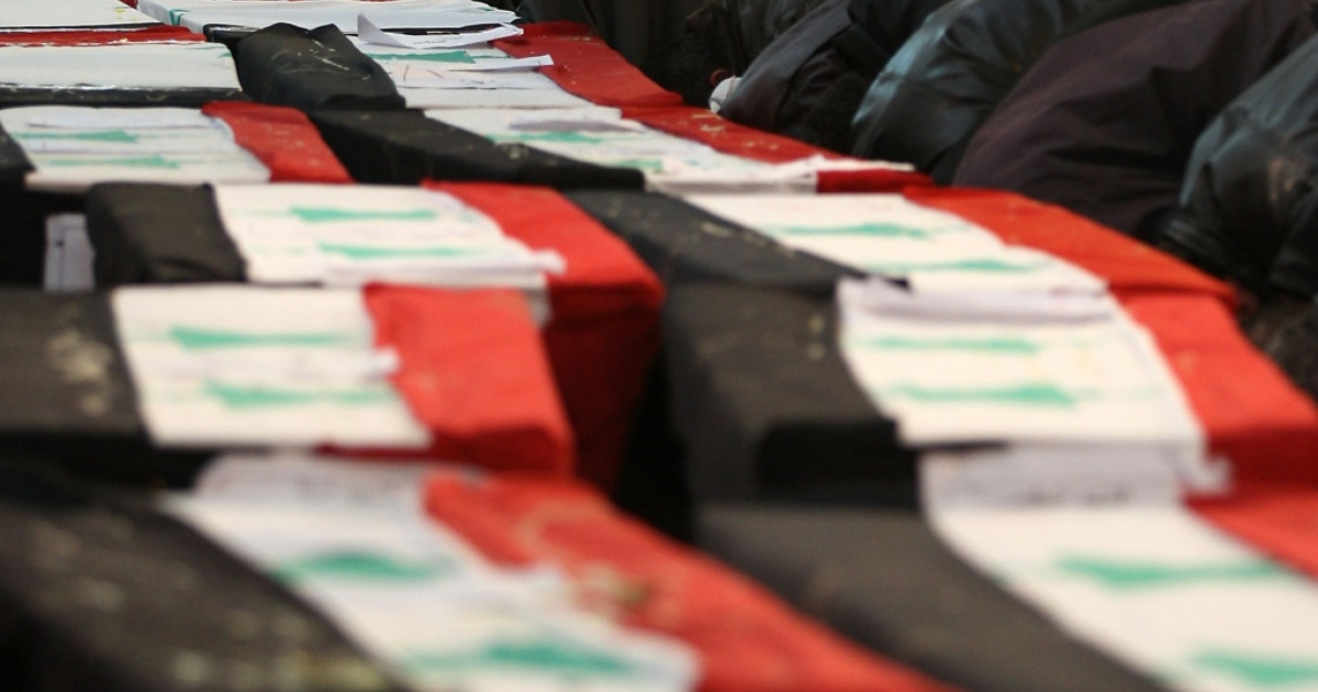 Coffins draped in Syrian flags at the funeral of 44 people killed in twin suicide bombings in Damascus on Dec. 24, 2011. GlobalPost uncovered mass killings in Saqba, just outside Damascus, after a crackdown by Syrian forces.</p>