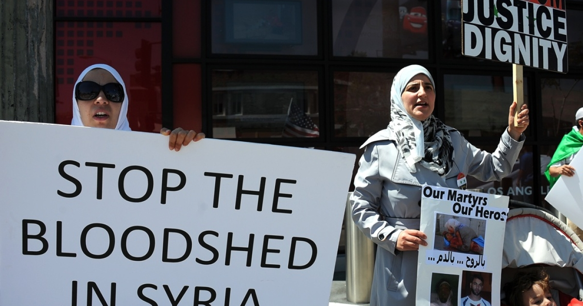 Demonstrators urge an end to violence in Syria on June 3, 2011 in front of the CNN building in Hollywood, California. UN chief Ban Ki-moon expressed alarm at the heightened Syrian government crackdown on protests, while a US-based monitoring firm said two-thirds of networks in protest-wracked Syria were cut off from the internet on Friday.</p>