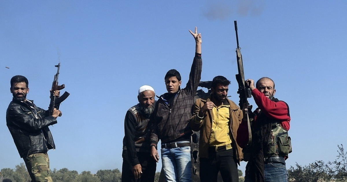 Syrian rebels celebrate a recent victory.</p>