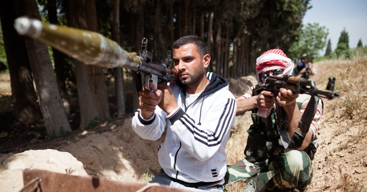 Members of the Free Syrian Army take part in a training session near Homs, Syria on May 10, 2012.</p>
