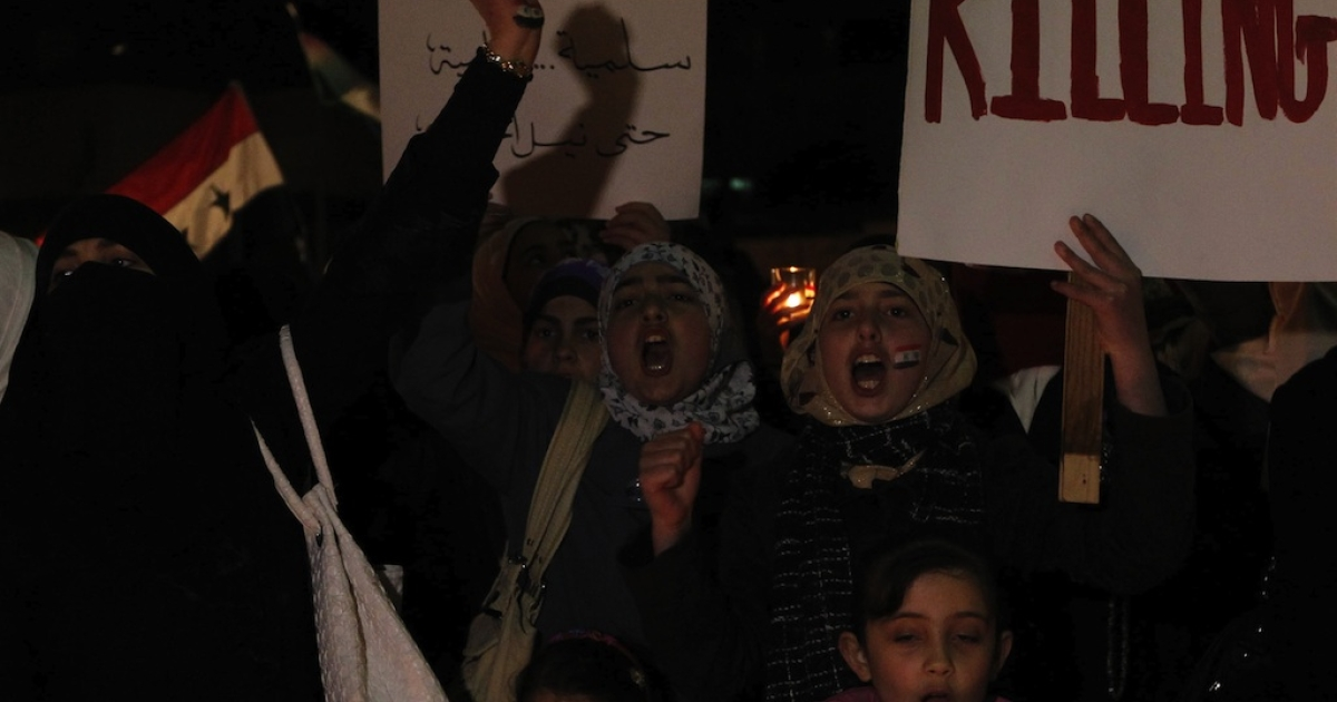 Syrians living in Jordan protest in front of the Syrian Embassy in Amman on April 9, 2011.</p>