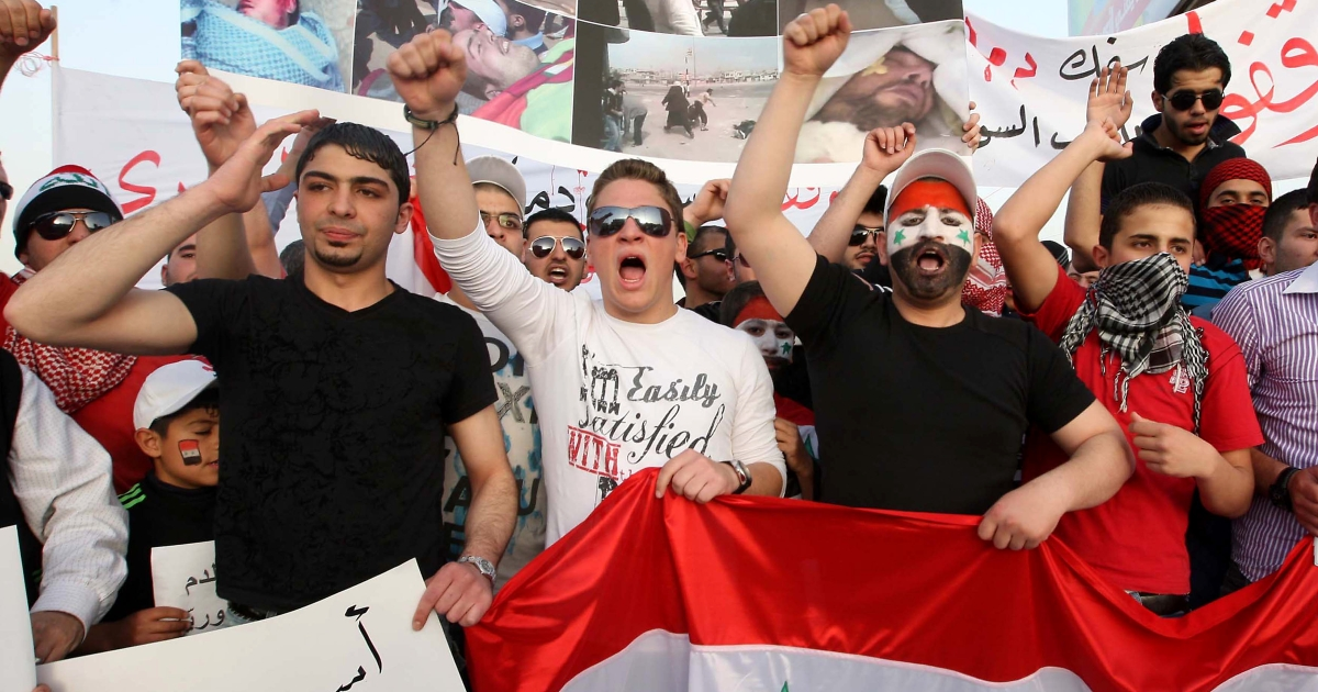 Syrian nationals living in Jordan shout slogans against Syrian President Bashar al-Assad during a demonstration in front of the Syrian embassy in Amman on April 17, 2011 as Syria was hit by new anti-regime protests.</p>