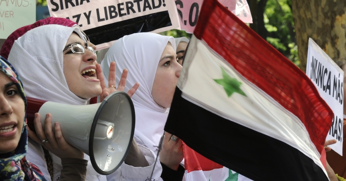 Demonstrators protest against the bloody crackdown by the regime outside the Syrian embassy in Madrid on April 24, 2011.</p>