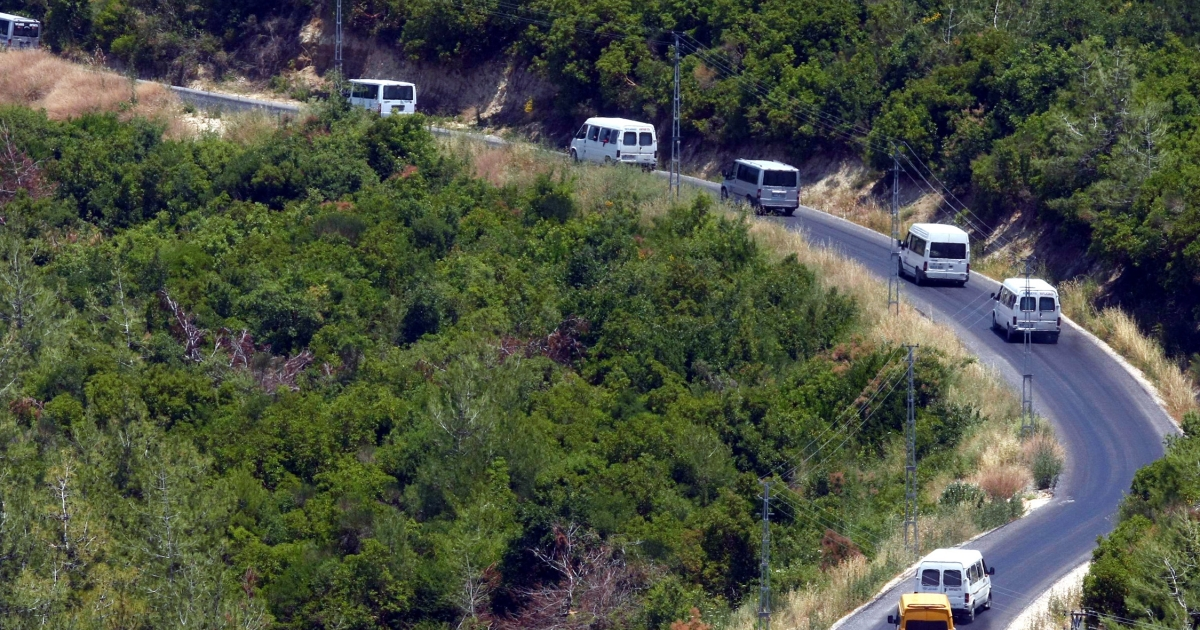 Cars carrying Syrian refugees drive after they entered Turkey at the border zone between Syria and Turkey, near the Turkish village of Guvecci, in Hatay, on June 23, 2011. Hundreds of displaced Syrians poured into Turkey after Syrian troops backed by tanks entered a border zone where thousands fleeing bloodshed had been camping in squalid conditions.</p>