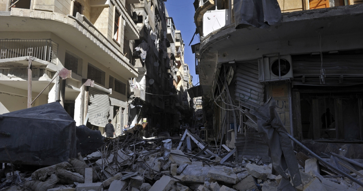 A general view shows destroyed buildings following shelling by regime forces on Syria's northern city of Aleppo on October 18, 2012. International peace envoy Lakhdar Brahimi called this week for a temporary ceasefire in Syria during the four-day Eid al-Adha holiday, which starts on October 26.</p>