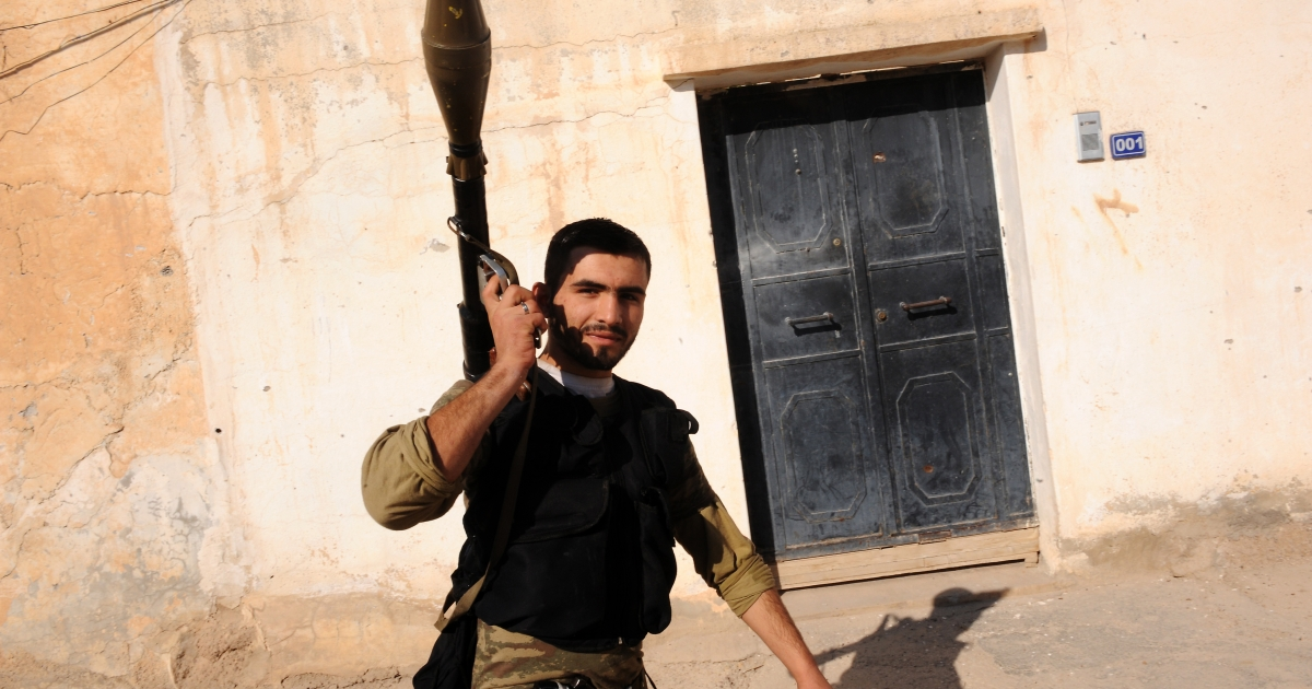 A Syrian rebel takes position in the town of Ras al-Ain near Turkey on November 16, 2012. Weapons shipments are making local and regional conflicts in the Middle East more lethal, scarring the societies where the weapons end up.</p>